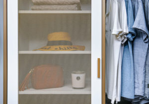 The mesh metal door on this 3-drawer cabinet allows items to breathe. This design feature was inspired by my daughter's closets. Once the configuration is planned, the system is shipped for self-installation, or California Closets can do it for you. (Photo by Andy Frame, andyframe.com)