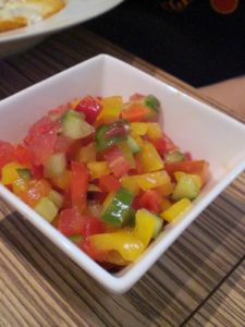 A classic Israeli salad - chopped tomatoes, cucumbers, and though not as common, peppers.