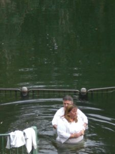 A woman about to be baptized