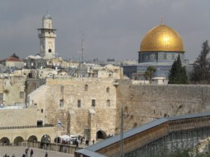The Western Wall, or Kotel, with the Dome of the Rock behind it
