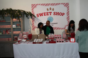 We created our own 'Sweet Shop' where we sold treats in Martha Stewart Crafts food packaging. Andrea DiPasquale and Stacey Spielman, pictured here, did a great job of decorating the shop and selling baked goods to raise money for the children of the George Washington Carver Residence. We're throwing them a holiday party with the $1500 we raised!