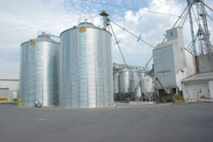 The Old and the new at Nature's Best - new organic corn bins erected in 2008 and original Kreamer Feed mill from 1953