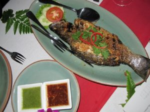 Grilled sea bass served with sambal belacan sauce - a spicy chili sauce