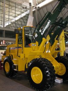 This is a large bucket loader, manufactured by Kawasaki, http://www.kawasaki.com/ which also makes the utility vehicles we use on the farm.