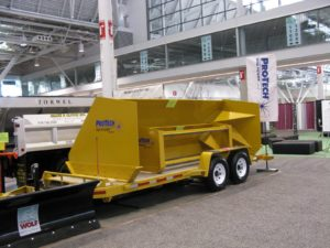 This is a Pro Tech snow pusher, http://www.snopusher.com/ which gets chained to the front of a backhoe, or large loader - it is frequently used to clear snow in large parking lots.
