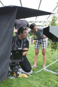 The crew was set up under the pergola framing the shot.