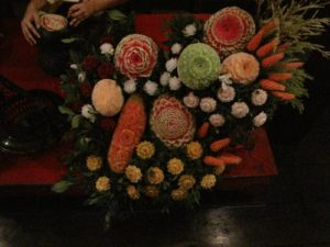 An expert fruit carver demonstrated her craft for us.