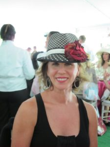 Gerri Kyhill wore a man's fedora in black and white.  She owns the S Factor gym in NYC - she has a very good figure.