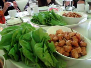 Food is served family style - we had lettuce wraps with delicious tofu and chicken filling.