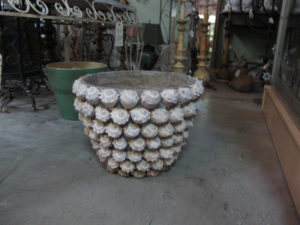 I saw many things I would have bought, such as this outdoor planter encrusted with small conch shells - perfect for my East Hampton place.
