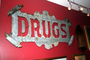 This is an old pharmacy sign made of sheet metal - quite fun.