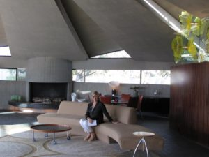 "Here I am in sitting beneath the soaring poured-concrete ceiling, punctuated with slivers of glass. This house has a cameo in the 1971 James Bond film, ""Diamonds Are Forever."""