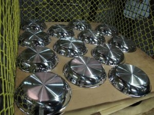 These polished fry pans are ready for their handles.