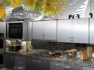 The Elrod house kitchen, with Dale Chihuly sculpture overhead