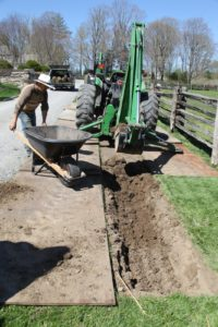 Sheets of plywood are used to protect the remaining lawn from all the equipment.