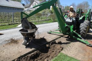 When the soil is removed from the trench, it's dumped into a wheelbarrow.
