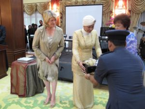 A presentation of gifts at the Queen's party - I was presented with superb examples of songket weaving while, I gave Her Majesty some of my books.