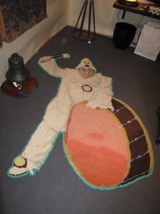 Praiseworthy Antiques, from Main Street in Guilford, NY had this very amusing hooked clown and drum rug.