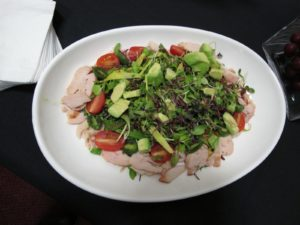 This is a beautiful salad of Ontario Organic micro green salad with avocado, smoked Ontario chicken, and charred grape tomatoes.