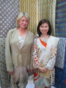 Here I am with Dr. June Ngo, director and designer for the Queen's Yayasan Tuanku Nur Zahirah organization.  This program has given a new life to traditional songket weaving - intricately woven sarongs and scarves, like those behind us.