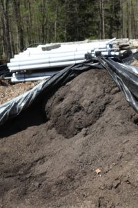 When the trench is dug, all the soil removed is taken to the composting yard.  This pile is rich composted soil.