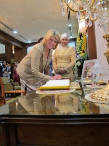 Signing the Queen's guest book in the Summer Palace while the Queen looks on - This photo appeared in many newspapers in Malaysia.