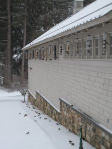 The eaves are a great place for the feeders - no squirrels have access, no matter how hard they try.