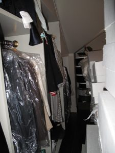 Many dry cleaner bags, diverse hangers, and mixed up categories - no organization at all!