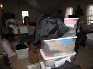 These tubs are full of older clothes, shoes, and oddities for donation.