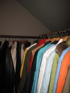 The coat closet is looking better with garments hanging on standardized hangers.