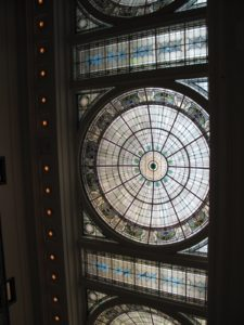 The ceiling of the old terminal is lofty with gorgeous stained glass.