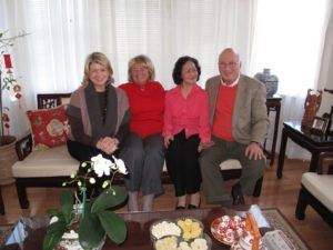 Sitting with Jane, Trieu Doan, and Steve in the Doan home.