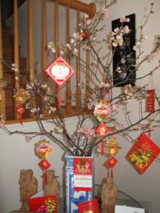 The New Year's decorations were colorful and pretty - Mrs. Doan forced the quince blossoms.