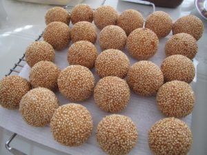 The rice flour balls, coated in sesame seeds, with a center of golden soy bean paste were very good.