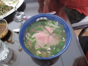 The green leaves are a member of the morning glory family - they have a very good, strong fresh flavor.  The broth is chicken, flavored with cilantro, star anise, green onions, and shallots.