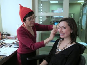Deb Genova, one of the TV makeup artists, applies Kristina's makeup.