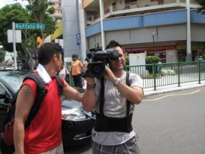 Next, we made a quick stop in Little India, the heart of Singapore's Indian community.  Here's our camera man Frankie.
