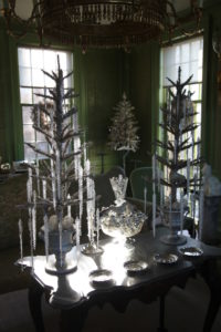 In the green room, these feather trees are dripping with icicles.