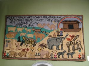I had never before seen Noah's ark depicted on a hooked rug.