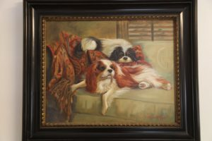 The walls are decorated with images of Cavalier King Charles Spaniels, beautiful dogs which Alex breeds - a lovely painting.