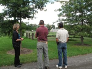 They stopped to admire the paddock fencing and the stable beyond.
