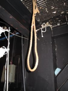 I wondered if this noose hanging backstage was there to provide a quick exit for dull speakers.  Ha-ha!