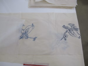Bird Embroidery being pieced together for a quilt