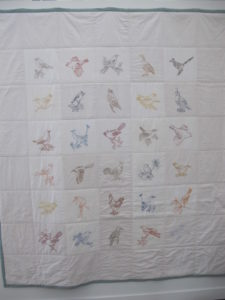 An embroidered bird quilt by Laura Normandin