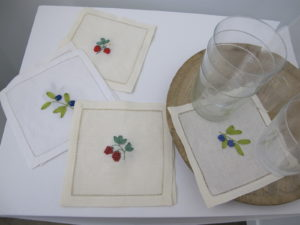 These pretty napkins are embellished with ribbon embroidery.