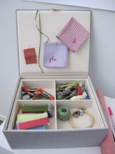 A treasured sewing box unveils its contents.