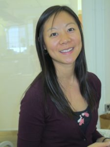 Stephanie Hung prepares pincushion materials.
