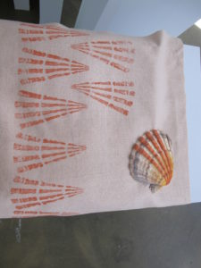 A scallop shell used for printing