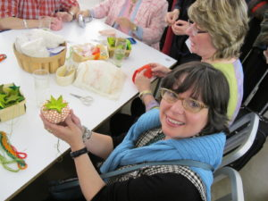 Guests demonstrate their sewing prowess at the pincushion booth
