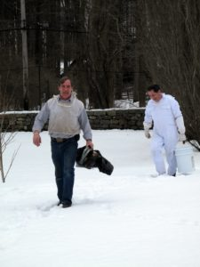 Guy and Carlos working their way through the snow to the beehives